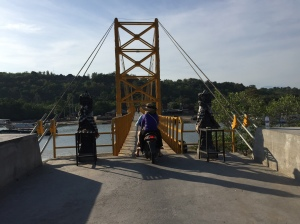 Exploring Nusa Ceningan by crossing the famous Yellow Bridge.