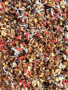 Let your granola cool down a little before adding fresh ingredients like coconut shred or dried goji berries